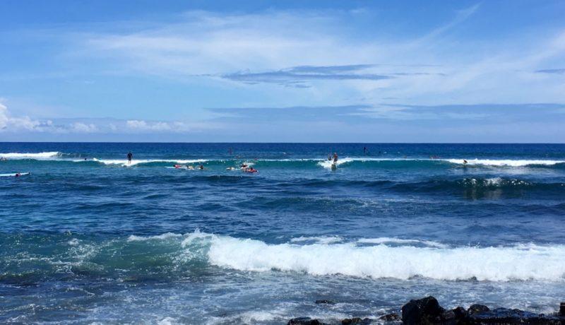 surfers at Kahalu'u bay