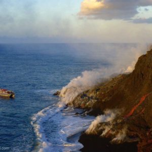 lava boat tour sees lava flowing into the ocean at the Big Island of Hawaii